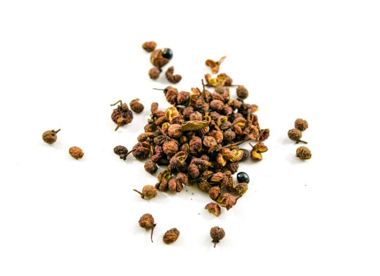 Sichuan or szechuan peppercorns isolated on white background. They numb the mouth when eaten.