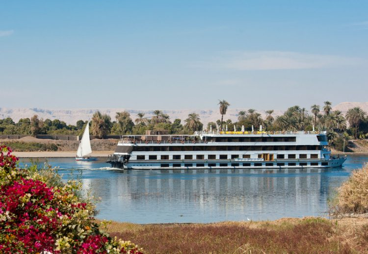 River boat cruising down the Nile at Luxor in Egypt