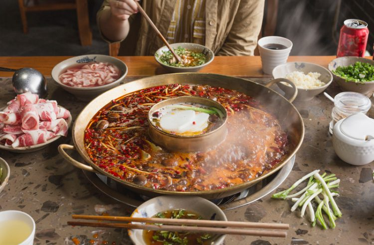 A person is eating hotpot scene in Sichuan, China