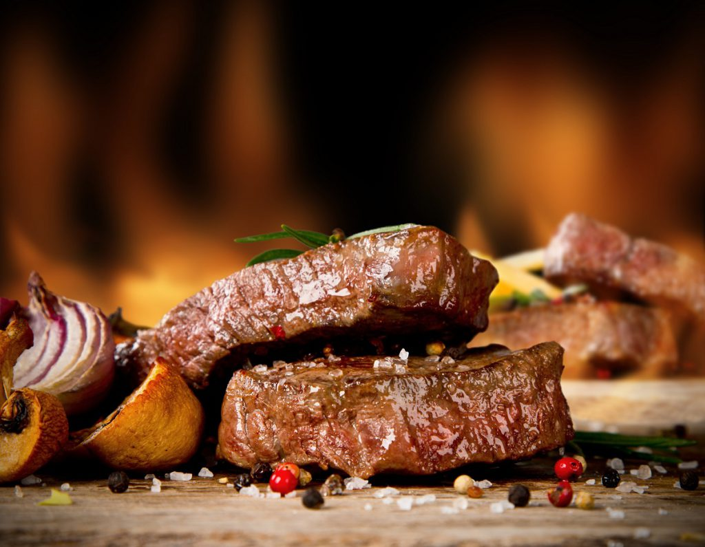 Delicious beef steaks on grill Fare Buzz